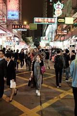 Lady walking (oyvind-nilsen) Tags: china city travel lady night hongkong asia neon mask streetphotography nighttime april fujifilm streetphoto kowloon mongkok nite reise streetshot cityshot 2016 x100 monkok xtrans x100t
