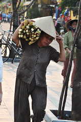 Life's not easy (Roving I) Tags: street vertical workers expressions vietnam hoian elderly transportation loads logistics sugarcane womenworkers conicalhats