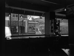 Mad City Frites (patrickkuhl) Tags: street people blackandwhite film monochrome wisconsin analog 35mm restaurant blackwhite shadows state kodak streetphotography olympus d76 madison filmcamera madisonwi xa statestreet olympusxa wisco selfdeveloped wisc filmphotography kentmere filmisnotdead kodakd76 madfrites