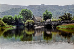 Near Llanberis (Robert J Heath) Tags: uk bridge lake wales landscape scenery cottage scenic snowdonia