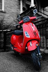 Red Vespa (Poocher7) Tags: red blackandwhite ontario building monochrome italian gate shiny vespa bricks scooter pillars markham redvespa motorscooter motorino selectivecolour isolatedcolour italianscooter