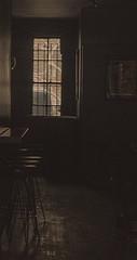 In a dark dark place (nrhodesphotos(the_eye_of_the_moment)) Tags: wood nyc shadow reflection window monochrome metal bar reflections backyard shadows manhattan interior lowereastside picture stool wwwflickrcomphotostheeyeofthemoment theeyeofthemoment21gmailcom dsc00524160