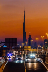 Streets of Dubai (oscarcablao) Tags: street skyline dubai cityscape horizon sigma burjalarab deira goldenhour redclouds deiradubai mydubai