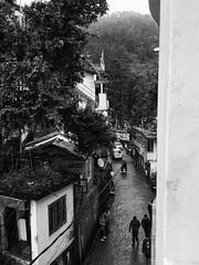 The Narrow Streets Of Little Tibet (Sahir Dhinojwala) Tags: india monochrome mono blackwhite himalayas dharamsala mcleodganj himachalpradesh narrowstreets littletibet dhauladhars iphoneography