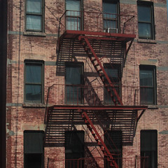 Red on Red (lefeber) Tags: city nyc newyorkcity windows urban newyork building architecture stairs downtown shadows decay harlem urbandecay bricks steps fireescape weathered railing