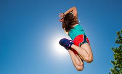 Mid-air (Flickr_Rick) Tags: summer woman girl outside athletic jump jumping legs bluesky jumpology