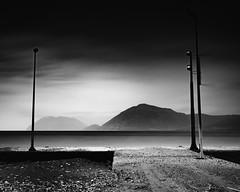 Escape (Christophe_A) Tags: longexposure sea bw mountain art 35mm landscape blackwhite nikon dramatic sigma greece filter nd christophe grad hitech manfrotto d800 patra nd110 christopheanagnostopoulos