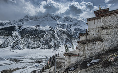 View of Braga from a temple (Nicolas Bourque) Tags: travel nepal mountains clouds trekking temple village hiking sony annapurna braga budism rokinon a6000 absolutelystunningscapes