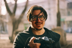 (Andrey Timofeev) Tags: street camera trees light portrait sunlight color film smile face strand analog 35mm hair photography glasses focus mood photographer wind kodak russia bokeh grain atmosphere sunny m negative 200 m42 plus zenit ttl manual mustache expired tones 44  helios helios44m   c41                  35         42 44 april2015 developbefore122008