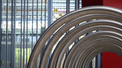 Circular Rack (Theen ... busy) Tags: park light red glass bicycle metal lumix hall stainlesssteel bright entrance adelaide shining racks tafe shallowdof tonsley theen technicalandfurthereducation