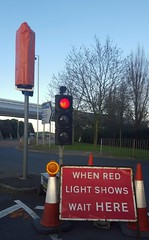 When Red Light Shows Wait Here (Stuart Axe) Tags: trafficlights trafficsignals trafficlight temporarytrafficlights southernperimeterroad roadworks londonheathrow heathrow airport london england uk gb whenredlightshowswaithere sign cones cone trafficcone trafficcones hatton unitedkingdom greatbritain lhr heathrowairport londonheathrowairport
