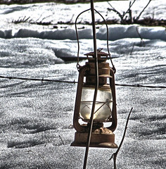 Cold Old Lantern (Eyellgeteven) Tags: lighting old winter light snow cold glass metal handle frozen rust portable antique steel rustic decoration rusty freezing dent flame rusted barbedwire oil oxidation hanging lantern bent retired barbed fuel dents wick kerosene rustyandcrusty dented oxidized oillamp kerosenelamp lampoil hurricanelantern barnlantern kerosenelantern coldblast eyellgeteven