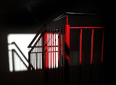 Escape (McRusty) Tags: light shadow red white black building fire escape shapes stairwell railings bannister