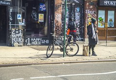 To Early For Happy Hour Libations On The Lower East Side Manhattan On Avenue A (nrhodesphotos(the_eye_of_the_moment)) Tags: windows winter shadow signs man glass girl hat bike metal bar scarf reflections paper season graffiti doors outdoor candid lowereastside wheels indoor streetscene pole sidewalk transportation stores happyhour handlebars libations shoppingbag dsc05823 lotterysign wwwflickrcomphotostheeyeofthemoment theeyeofthemoment21gmailcom