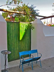 Have a blue seat (vittorio vida) Tags: street door blue green colors chairs seat stromboli