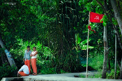 I'm watching you (Quicksil7er) Tags: red party portrait india men green hammer candid flag watch communist jungle sickle region