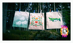 Hand Painted Bags Waiting for ironing (Villa Ylle) Tags: fish art finland bag folkart hand sheep tulips recycled cut painted folklore textile printing pike dyeing tote lino pellinki