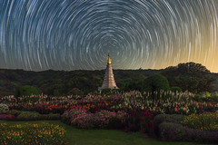Star Trail at pagoda on the top of Inthanon mountain, Chiang Mai, Thailand. (Alongkot.S) Tags: park travel blue light red motion night dark landscape thailand star colorful long exposure natural outdoor horizon peak clear trail astrophotography western rotation starry geological