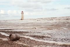 The famous Lighthouse at Talacre Beach. (rogerlloydwilliams) Tags: sea brown lighthouse seaside waves barrel dirty rough seahorses roughsea rogerlloydwilliams