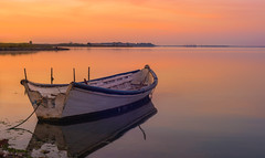 sunrise (robimurgia) Tags: ocean sardegna sea sky italy orange reflection nature water beautiful beauty marina sunrise reflections relax boat pond sardinia quiet gulf calm tranquillity naturephotography