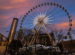 Skyview Ferris Wheel (Mark Chandler Photography) Tags: street city longexposure pink atlanta sunset orange color colour fountain night ga buildings georgia photography lights evening photo colorful dusk atl stock rings ferriswheel olympic fountains streetcar westin centennialpark skyview markchandler skyviewferriswheel connectdowntown