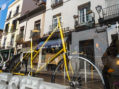 On Golden Bike (real ramona) Tags: madrid street reflection window bike bicycle shop glitter gold golden colours bicicleta sparkle cycle vlo fiets