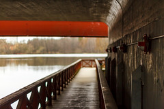 Under the bridge (fredrik.gattan) Tags: bridge lake reflection field pier canal spring dof sweden stockholm tunnel walkway depth bromma ulvsunda