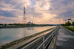 Power Tower in Okinawa (ErikFromCanada) Tags: pink sunset sky orange reflection tower beautiful japan clouds river warm power angle path sony wide dramatic strong okinawa iconic ultra a7r