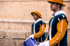 City drummers at the gate (zilverbat.) Tags: world city travel portrait people blur male photography town scenery dof bokeh citylife culture streetphotography streetscene malta tourist portret oldtown tourisme mdina streetshot reizen citytrip streetcandid peopleinthecity straatfotografie zilverbat