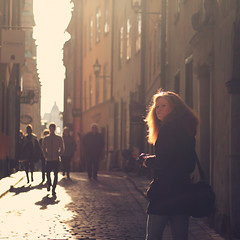 Light chaser... (Lollyx34) Tags: street city light shadow people woman backlight canon 50mm europe sweden stockholm candid oldtown
