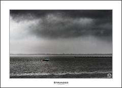 Stranded (John_Armytage) Tags: cloud storm rain boat jetty australia nsw centralcoast canon70200 longjetty sonya7r2