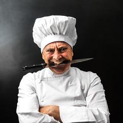 Dollarphotoclub_70438681 (procurandoalgo) Tags: italy uomo chef bianco ritratto mordere cappello strano pazzo uniforme lavoro professione pericoloso buffo cuoco cucinare coltello maschio professionista divisa isolato cattivo grembiule allavoro caucasico agguerrito cappellodacuoco