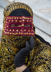 a bandari woman wearing the traditional mask called the burqa on a market, Hormozgan, Bandar Abbas, Iran (Eric Lafforgue) Tags: portrait people woman vertical outdoors gold golden persian clothing asia veil mask iran market muslim islam religion hijab persia headshot hidden covered iranian bazaar adults adultsonly oneperson islamic burqa ethnicity middleeastern persiangulf sunni bandarabbas burka chador 20sadult youngadultwoman balouch hormozgan onewomanonly burqua   embroidering 1people  iro straitofhormuz  colourpicture  borqe boregheh iran034i1965