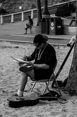 Inspiration (AnAdventureInPhotography) Tags: ocean california street musician music tree beach water hat sunglasses trash pen writing notebook necklace chains sand chair shoes artist afternoon pacific guitar tshirt pacificocean oceanside skateboard shorts folder waterbottle foldingchair earbuds penandpaper crosslegged snapback