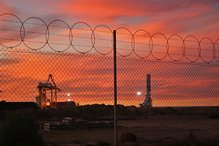 Lights and razor wire (Bingley Hall) Tags: sunset port australia barbedwire adelaide southaustralia razorwire pelicanpoint outerharbor