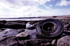 DSC00785 (weekend_vagabond) Tags: uk winter cold abandoned beach car wheel metal stone walking sand rust rocks stitch walk pano yorkshire perspective cable huts hut scarborough washed colourful beachhuts stitched tyre filey panoramimc