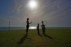 Jaffa (Hemo Kerem) Tags: street sea sky people green grass clouds canon israel telaviv sony jaffa mf 24mm juggling alpha juggler manualfocus tlv fd canonfd telavivjaffa canonfd24mmf28 a7rii sonya7rm2 a7rm2