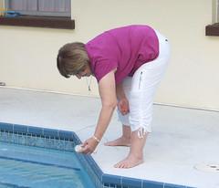 Checking (clarkfred33) Tags: pool mood swimmingpool temperature thermometer swimwear cargopants whitepants wetsdventure