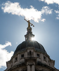 The Old Bailey (cocabeenslinky) Tags: old city uk blue england sky sun white london bronze clouds court lumix photography gold for justice leaf mayor photos g seat centre united capital central fluffy kingdom lord east panasonic corporation criminal bailey dome figure sword end april crown courts 18 1785 shining 60 balanced glint gilt eastend guilded scalesofjustice the 2016 vario metres equally of ec4m 7eh dmcg6 cocabeenslinky swordofretribution