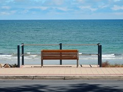 Bench with Pointless Fence (mikecogh) Tags: blue beach fence bench coast brighton horizon paranoid waste scared pointless