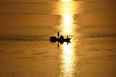 ..    ... (eyenamic) Tags: sunset reflection silhouette river evening boat nikon afternoon boatman d5100
