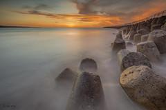 Calm before the storm (melnikor) Tags: sunset sea sky bali cloud sun seascape beach water rock set indonesia landscape land scape leehuaming