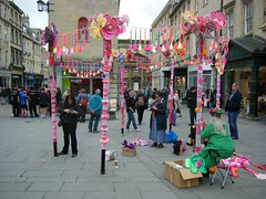 Yarn Bombing for Cancer Care, City of Bath, England (rossendale2016) Tags: tim collection consuming time way money raising england kingdom united uk talented functional artist pavement lampposts posts lamp decorated decorating improvisation unusual day sunny idea clever women ladies shops roads tourists public attention attracting provoking thought thoughtful attractive tourist photogenic charity worthwhile fantastic crochet knit knitted knitting wool woollen colourful signs street city bombing yarn care cancer yarnbombing bath