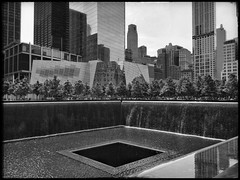 30 June 2014 (Rob Rocke) Tags: nyc newyorkcity trees people blackandwhite bw fountain monochrome buildings memorial manhattan worldtradecenter 911 wtc september11 visitors groundzero 911memorial sept11th mourners snapseed