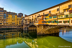 Ponte Vecchio (PramioGarson) Tags: old city travel bridge blue vacation sky italy reflection building art heritage history tourism monument water yellow architecture river landscape town florence italian ancient colorful europe european day cityscape arch view traditional famous culture sunny landmark tourist panoramic medieval historic ponte tuscany firenze arno toscana renaissance hdr touristic vecchio