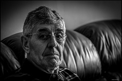 Dad Resting after a long Dog Walk. (mattpacker1978) Tags: old family portrait blackandwhite bw home monochrome canon pose dark 50mm grey glasses dad shadows father relaxing shades couch sofa parent age older specs resting dslr aging wrinkles greyhair nocolor nocolour 700d