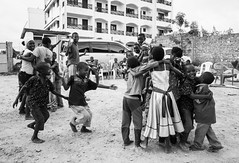 Orphan kids in Mombasa, Kenya, playing a game in which they have to hug in groupings of a given number. (Matt Wicks / GreatDistances) Tags: africa playing smile kids children fun kid hugging hug play pentax kenya games ricoh ricohgr mombasa eastafrica 2015 ricohgrv