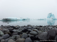 Iceland - Icy beach (Photographer Rita Brum) Tags: light ice nature water beauty landscape island lava iceland seaside rocks outdoor stones scenic landmark hike glacier flowing iceberg sight geology viking visitor majestic beatiful basalt polarcircle jkulsrln icelandic floatingice northerneurope sightseer idylli breiamerkurjkull northiceland summer2015 fotografritabrum photographerritabrum aeternono