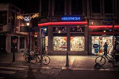 Videotheque (Gilderic Photography) Tags: street city windows urban cinema bicycle shop night canon lights belgium belgique belgie lumiere cinematic rue liege nuit ville 500d gilderic