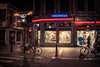 Videotheque (Gilderic Photography) Tags: street city windows urban cinema bicycle shop night canon lights belgium belgique belgie lumiere cinematic rue liege nuit ville 500d gilderic